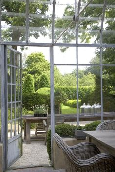I'm wondering I you could find an old greenhouse and turn it into a garden room. Love the feel of steel beams and glass in a lush garden Outdoor Rooms, Outdoor Gardens, Indoor Outdoor, Outdoor Living, Outdoor Decor, Formal Gardens, Orangerie Extension, Beautiful Gardens, Beautiful Homes