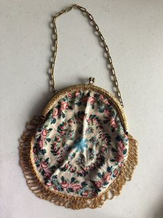 I recently repaired a sweet 1920s beaded purse for my friend's Etsy shop. Not only did I get to handle and examine this beautiful little object, but I had lots of fun figuring out how to make and attach a new lining.  http://annquiltsblog.blogspot.com/2018/05/vintage-1920s-beaded-purse.html