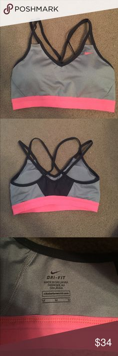 Nike Sports Bra Super cute grey with pink band Nike sports bra. Only worn two or three times. In great condition. Comes with removable pads. Has mesh detail on the back for ventilation. Size is a women's Medium. Nike Intimates & Sleepwear Bras