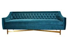 This sofa is designed with clean lines, lavish tufting, and a deep, comfortable seat. The bold cotton velvet upholstery help makes the piece pop and pairs beautifully with the silver finish of the...