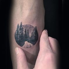 Small circle shaped stippling style tattoo of night forest road (Small Tattoos Mountains)
