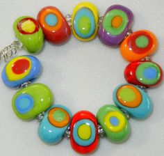 Colorful Teeny Tiny's by DIF Designs Lampwork Glass Beads  CARNIVAL. $28.00, via Etsy.