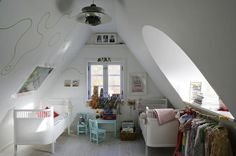 I want an attic that looks like this-Love the circular window and design on the wall. So tranquil.