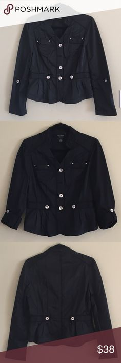 WHBM Black Blazer Jacket Cute black blazer with silver button details and slight ruffles on hem.  Small collar, v-neck, fitted & cinched in waist with two buttons on back. Button closure on sleeves to roll up. 63% polyester, 37% nylon. In excellent condition, no known holes, stains or defects. Shows normal wear & wash. From smoke & pet free home. White House Black Market Jackets & Coats Blazers