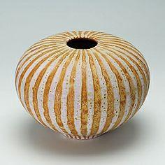 Orange vessel   by Peter Beard
