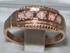 ENGLISH 9CT ROSE GOLD COLOURFUL FIERY OPAL BAND RING