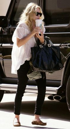 white oversized tee, black jeans, smoking flats, black bag with gold accents