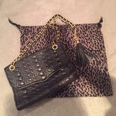 Rebecca Minkoff Black Purse This authentic Rebecca Minkoff is beautiful for any special occasion, classy & works well as an everyday bag. It's in like new condition. No rips or stains. Also comes with the dust bag!   ❗️ABSOLUTELY NO TRADES & NO ️️❗️ Rebecca Minkoff Bags Shoulder Bags