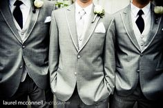 A great example of the groom and groomsmen wearing grey suits with the groom standing out with the lighter tie