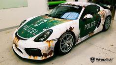 Porsche Cayman GT4 Cup in rusty police design