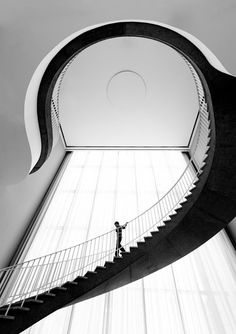 """The black and effort is stunning, of course. But honestly, the swirl of the stair seems to slash/break the very rectangular line of the window. For me, the one distracts from the other. """"Who left the staircase in front of the window?"""""""