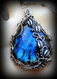 Labradorite Pendant by tangocatgems1, via Flickr - I like the combination of wire and metal (PMC?) vines