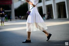 Woman wearing a perforated white skirt