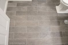 Plank bathroom floor tiles - grout - minimum grout joint that you can have is 1/16th of an inch. The recommended minimum for plank tiles is 1/8 inch (recommended by the tile industry). I would also recommend 1/8 inch if possible. You can do smaller but you are increasing the difficulty of the installation.