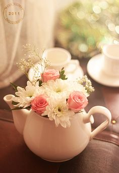 Flower Tea Pot - If I had a creative bone, I would have used my lovely teapots for a flower vase.
