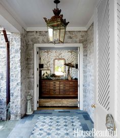 """The entry should unfold in a way that captures your interest and tells you 'this is what this home is about."""" The feeling it evokes as you pass through is the most important element and accomplished through the blend of texture, light, tone and real aged materials - an alchemy that is unique to just this place."""