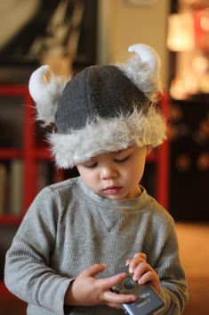 I had hoped to get more done, but I am so proud of this little hat, I don't really care. It is basically a little fleece cap with some pretty awesome Viking flair. Presents For Boys, Gifts For Boys, Halloween Costumes For Kids, Diy Costumes, Sewing For Kids, Diy For Kids, Viking Helmet, Helmet Covers, Dragon Party