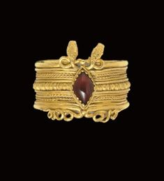 A Greek gold and garnet finger ring, Hellenistic period, circa 3rd century B.C.