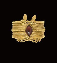 A Greek gold and garnet finger ring, Hellenistic period, circa 3rd century B.C.