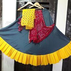 [New] The 10 Best Outfit Ideas Today (with Pictures) - Grey ghaghra with yellow ruffle and mirror work blouse and bandhni dupatta available. Chaniya Choli Designer, Garba Chaniya Choli, Garba Dress, Navratri Dress, Lehnga Dress, Chaniya Choli For Kids, Bandhani Dress, Lehenga Gown, Choli Blouse Design