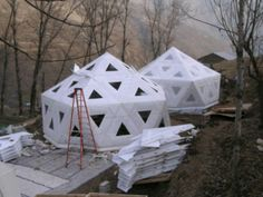 Icosa village pods - cheap, warm, durable.  Used here for earthquake relief in Pakistan