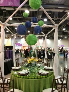 Columbus Bride: The Show Green apple table: Fruit wood chiavari chairs, lime green dupioni linen, white hemstitch napkins, brown wicker chargers, Maisonette china, Mexican green glassware, Croydon flatware. Florals provided by The Avant Garden.