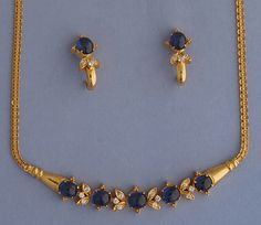 Diamond & Blue Sapphire set This 21k Gold necklace & earrings set is ahead of its time. Length of the necklace is 16 inches. The set is studded with Total Weight of diamonds is 0.55 carats & 15 carats of blue sapphires.