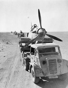 A Commer of No. 53 Repair and Salvage Unit, transport salvaged Hawker Hurricane fuselages through the Western Desert for repair at the Hurricane Repair Section, Helwan, Egypt Ww2 Aircraft, Fighter Aircraft, Military Aircraft, Image Avion, Afrika Corps, North African Campaign, Hawker Hurricane, Ww2 Planes, Vintage Airplanes