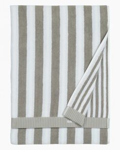 Made of thick cotton terrycloth, this hand towel features stripes in different widths on each side. Pattern: Kaksi raitaa Pattern Designer: Kristina Isola Material: 100 % Cotton Size: 75 x 150 cm ( x ) Color: grey, white