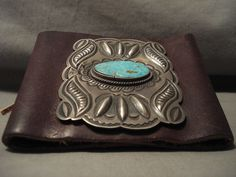"""This is a very old piece and it carries a very rare old blue turquoise stone. Surrounding the stone are remarkable hand repoussed silver shells with accenting sun patterns. The silver plate measures around 3"""" X 2-1/2"""".   eBay!"""