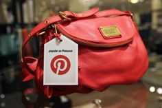 """""""A look at why social media site Pinterest is catnip to retailers and shoppers alike"""" -- Shown: """"This undated image provided by Nordstrom shows a handbag made popular on Pinterest that is available at Nordstrom stores..."""""""