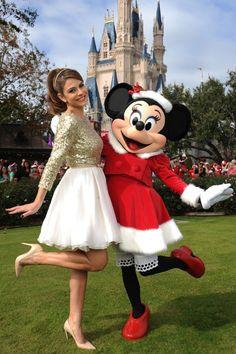 "Parade co-host Maria Menounos poses with Minnie for ""Disney Parks Christmas Day Parade"" at Walt Disney World Resort"