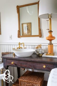 """turning a vintage piece into a new sink vanity... """"antique"""" the plumbing pipes under the sink with paint to unify the whole look"""