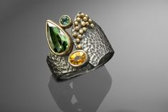 Our one-of-a-kind oxidized sterling silver, 18k gold, tourmaline, sapphire and tsavorite  Peruvian ring.