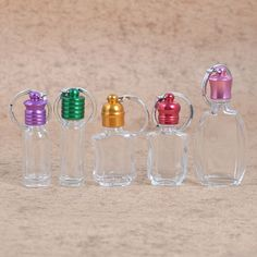 MUB unique design mini portable essential oil bottle , small mouth clear glass bottle with colorful metal cap Essential Oil Bottles, Essential Oils, Empty Glass Bottles, Bottle Bag, Key Rings, Clear Glass, Personality, Stud Earrings, Cap