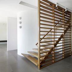 Modern stair spindles...love this for a basement remodel
