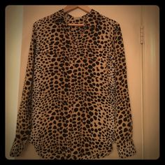 Equipment Cheetah-Print Blouse A 100% silk, cheetah print blouse. Looks great paired with a pant suit or pencil skirt for work. Equally flattering with denim or coat/leather pants. Equipment Tops Blouses