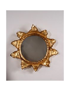 The Sun Ruffle is a whimsical design by Elizabeth Canner. The original prototype was sculpted by Canner in clay. The handmade quality of this burst mirror is charming and artistic in either Antique Gold leaf or Silver Leaf with a convex mirror.....Elizabeth Canner Designer/Sculptor