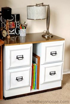 Craft/Sewing Room glue picture frames to file cabinet drawer fronts for an updated look...nice!