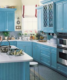 WOW! I love everything about this kitchen..well, not too crazy about the curtain! Ha!