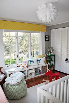 love this space... great light and color and the window seat is functional sna hold storage-  Love this!