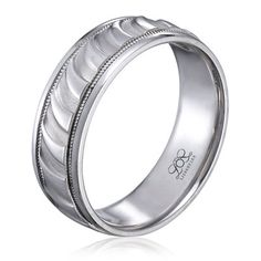 Men's wedding band with carved surface from Lieberfarb