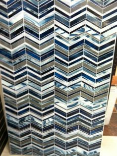 Architectural Ceramics Devotion glass chevron.  Board displayed in our Rockville, MD Showroom