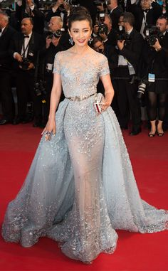 2015 Cannes: Fan BingBing is wearing an ice blue sheer short sleeve Zuhair Murad gown with a train and embellishments. I remember this dress on the runway! I'm excited that someone chose this gown to wear on the red carpet because it is one of my favorites from Zuhair Murad's collection! I'm a big fan of ice blue.