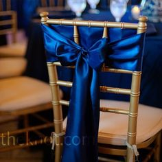 Blue and silver and add accents of coral some how? Back of bridal party chairs at reception