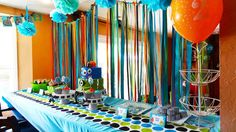 mod monster birthday party - love the ribbon/streamer backdrop! maybe doorway curtain