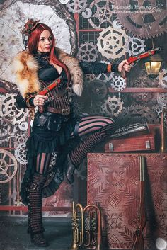 Redhead Steampunk Woman in Stripes and Fur - For costume tutorials, clothing guide, fashion inspiration photo gallery, calendar of Steampunk events, & more, visit SteampunkFashionGuide.com