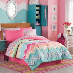 Transform your little girl's room into a bright, cheery space with the Marielle Complete Comforter Set. The set features bold chevron prints in a rainbow of colors with solid, deep pink accents and includes a comforter, shams, bed skirt, and sheet set.