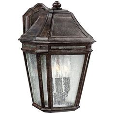 Add a traditional touch to you home's exterior with this weathered chestnut outdoor wall light that's made from StoneStrong composite cement.