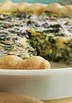 Spinach Quiche — This cheesy spinach quiche recipe gets its smoky flavor from crispy bacon crumbles. For a delightful breakfast, serve with a seasonal fresh fruit salad.